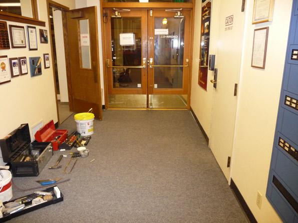 Carpet repair in firehall -before